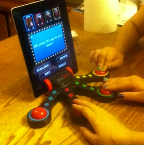 The cool attachment makes it easy for 4 players to enjoy this awesome trivia game.